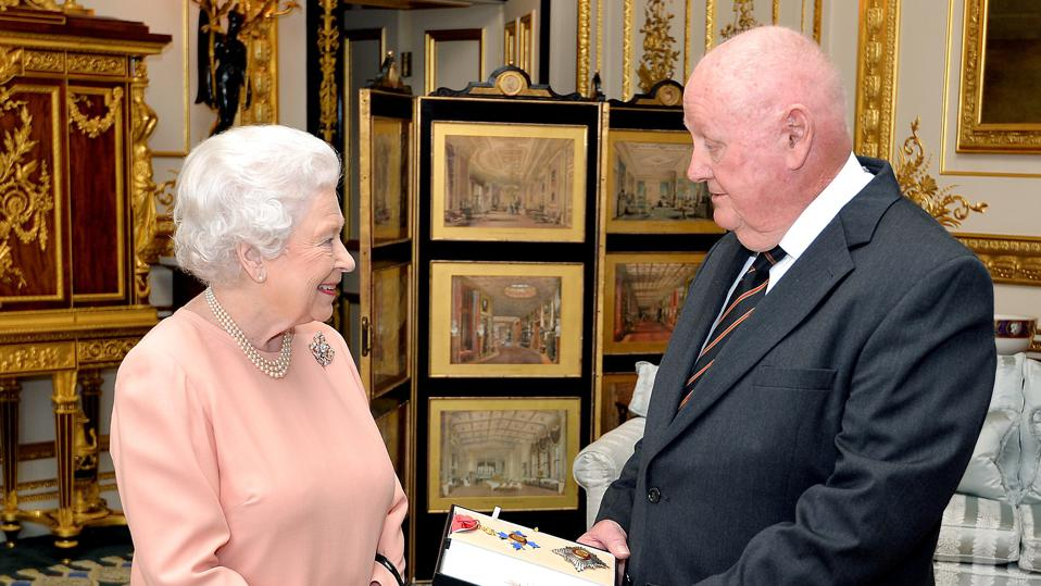 John Mars with Queen Elizabeth II