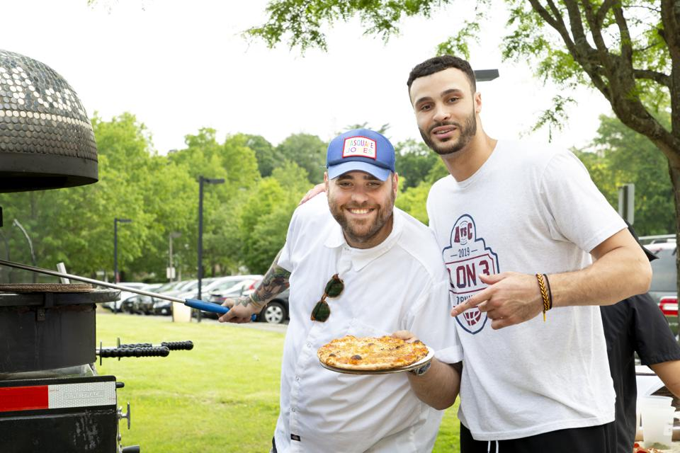 Cleveland Cavaliers forward Larry Nance Jr. stands with Food Network chef Christian Petroni