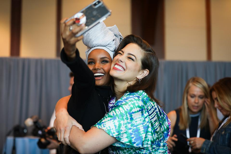 Models Halima Aden and Ashley Graham pose at Forbes' 2019 Women's Summit.