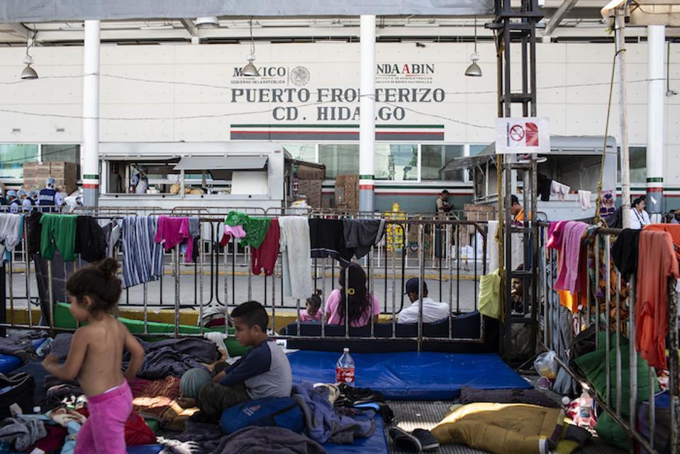 Migrant children and families at the Mexico-Guatemala border in Ciudad Hidalgo, Mexico.