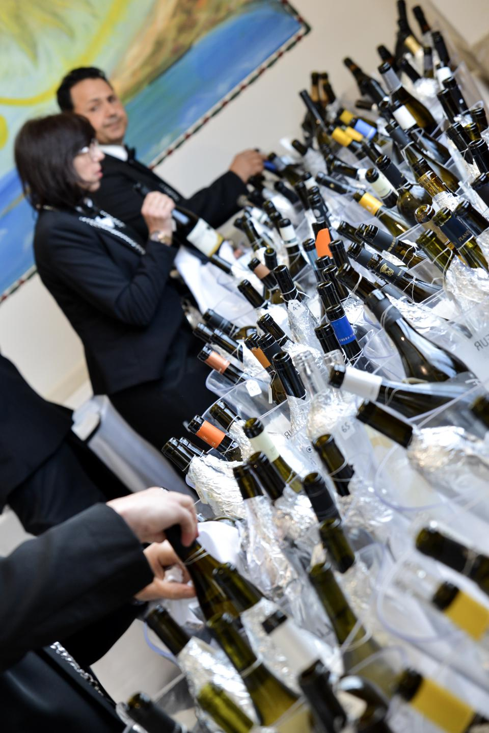 Sommeliers pouring Sicilian Wine