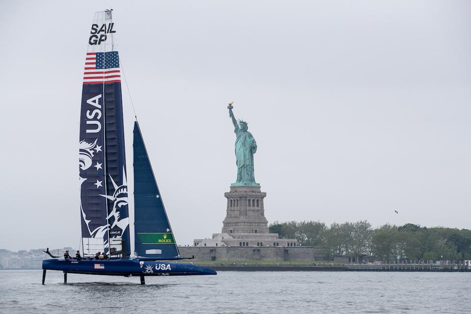 US SailGP team ″Lady Liberty″ flies past Lady Liberty in New York Harbor this week.