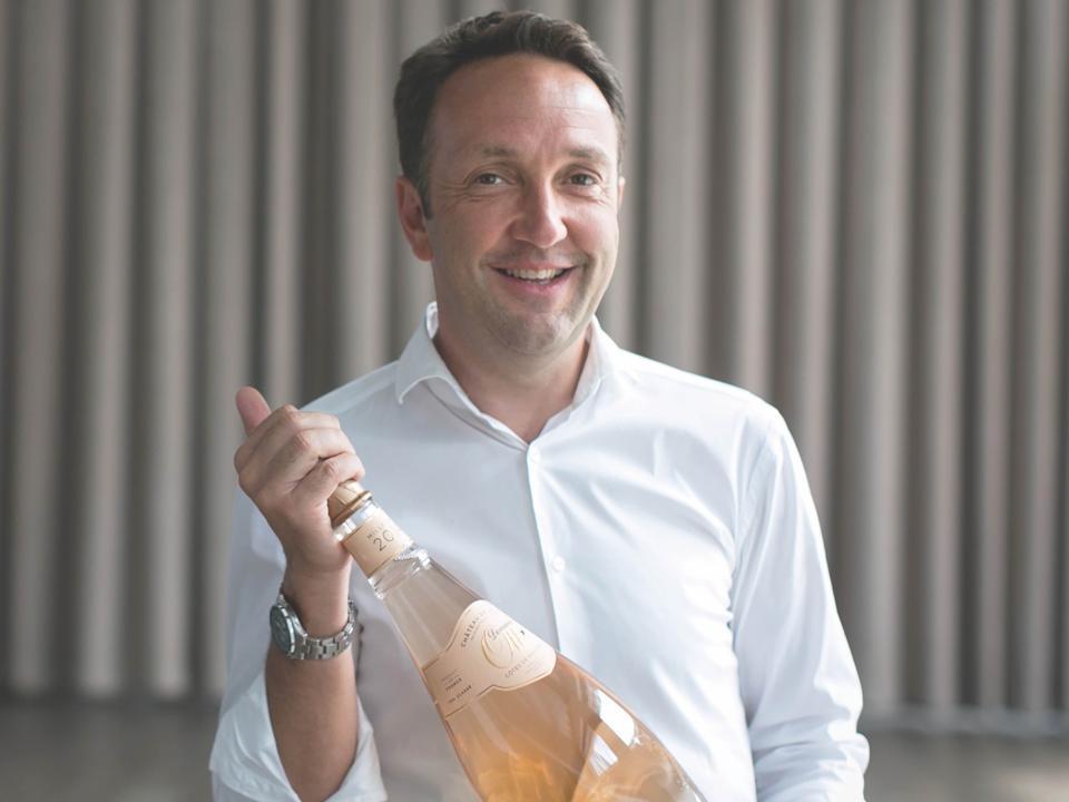 Jean-Francois Ott Holds a Bottle Of His Clos Mireille Rosé From The Cote De Provence