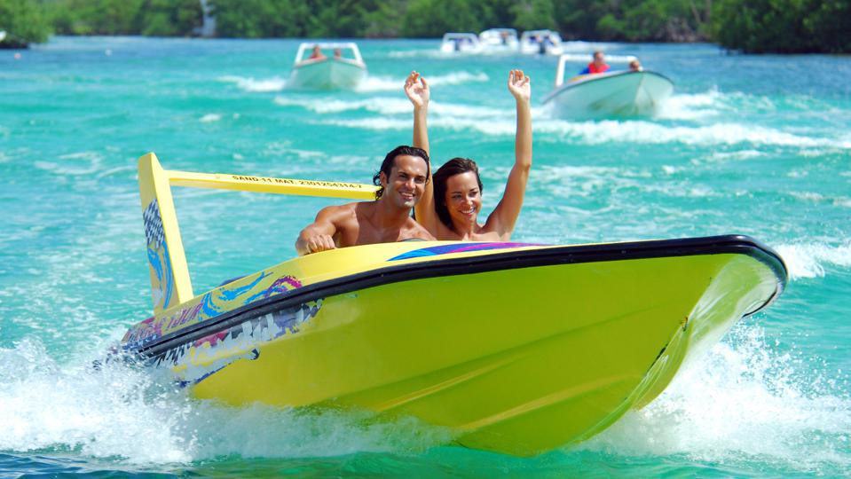 two people on a speedboat