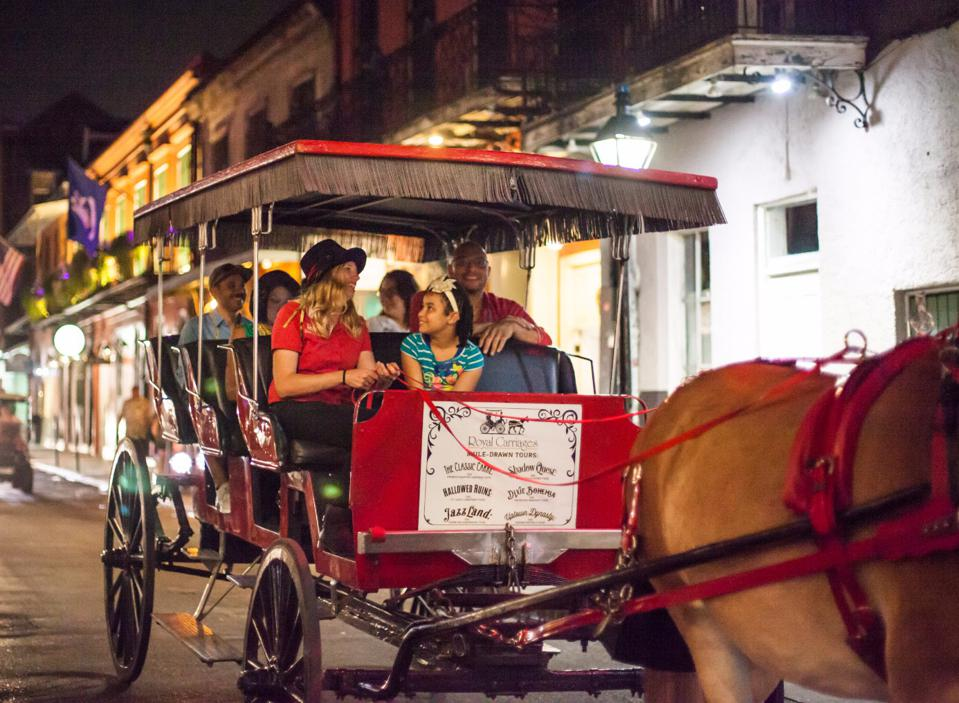 Family on a carriage ride at night