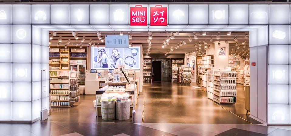 An exterior shot of a MINISO store