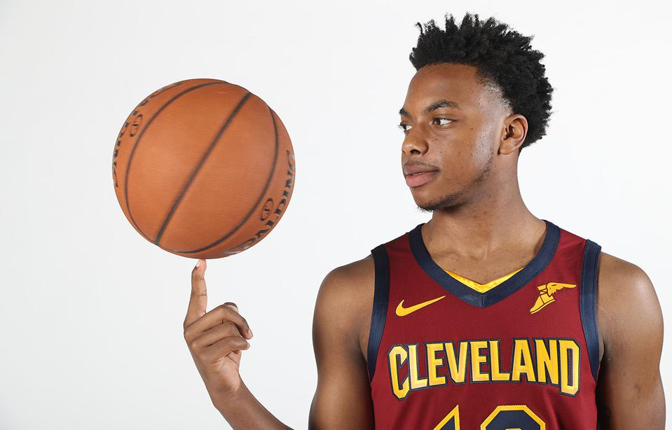 Darius Garland poses with a basketball for his new team, the Cleveland Cavaliers.