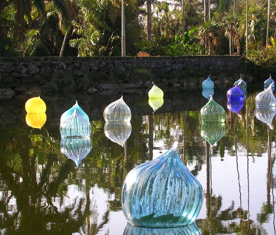 Floating sculptures in a lake.
