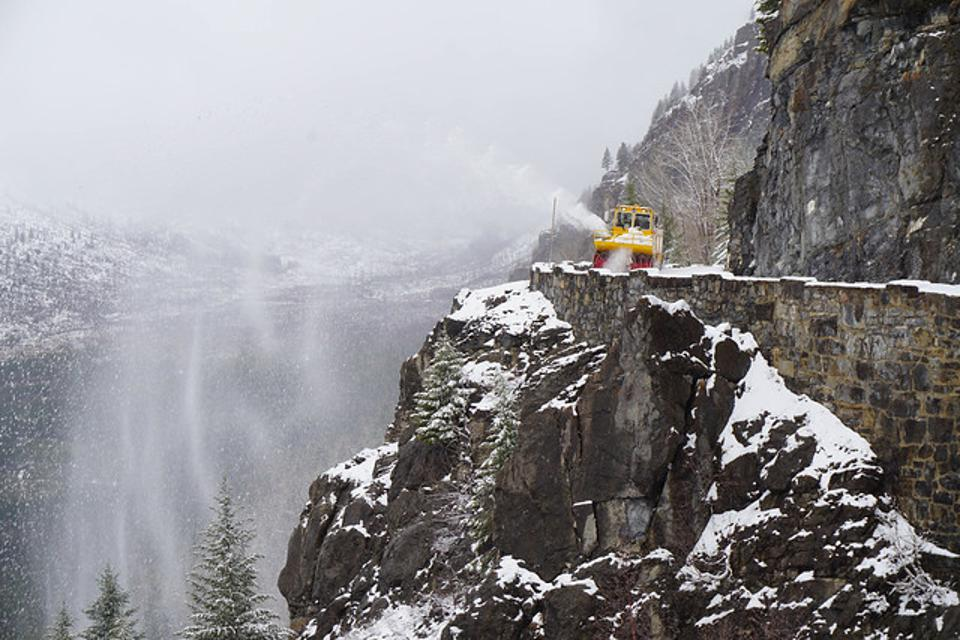 Plows work to clear Going to the Sun Road of winter snow.