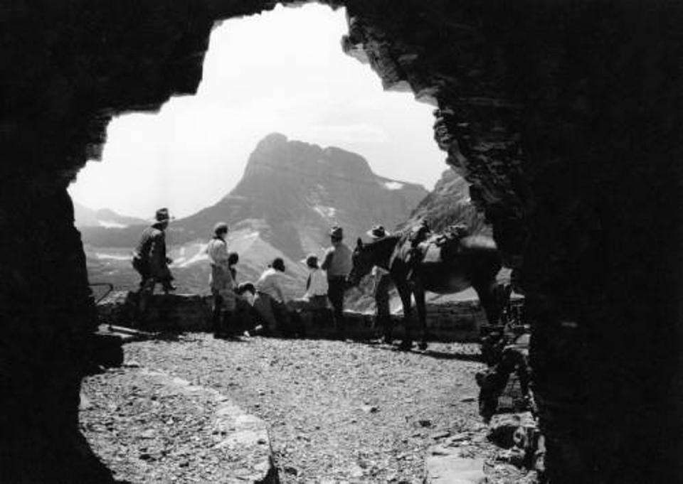Workers take a break from construction on Glacier's Going to the Sun Road.
