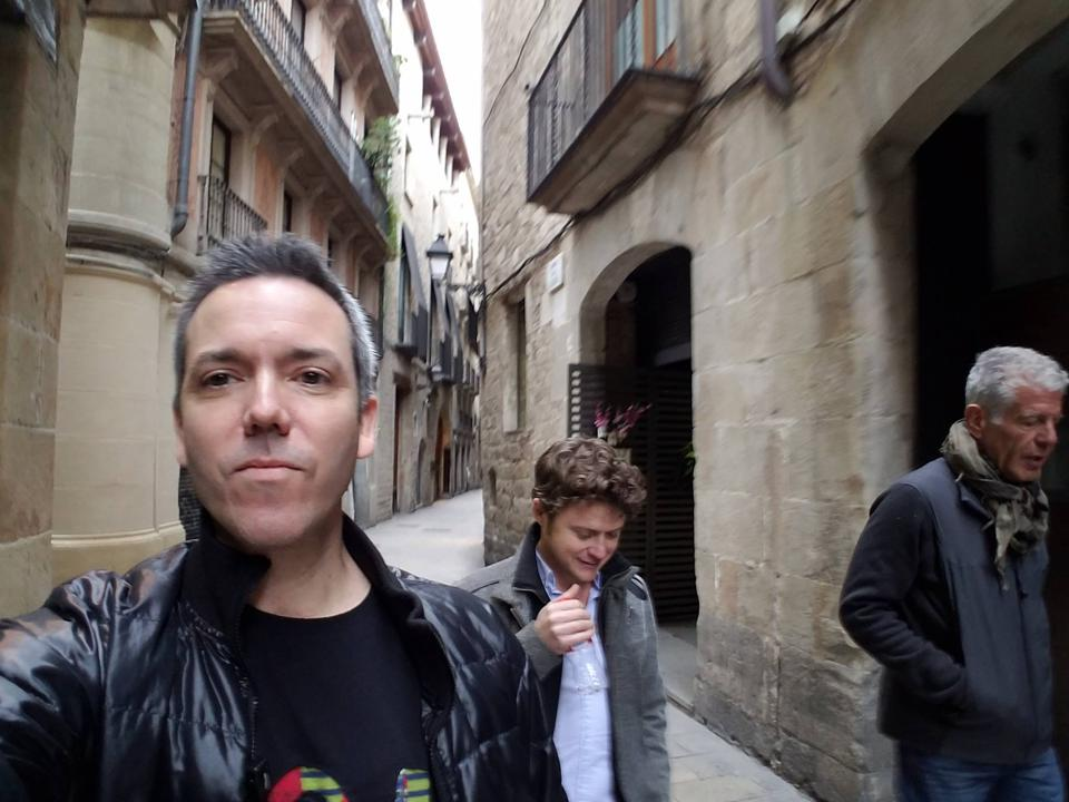 Nathan Thornburgh, Matt Goulding, and Tony Bourdain walk In Barcelona.