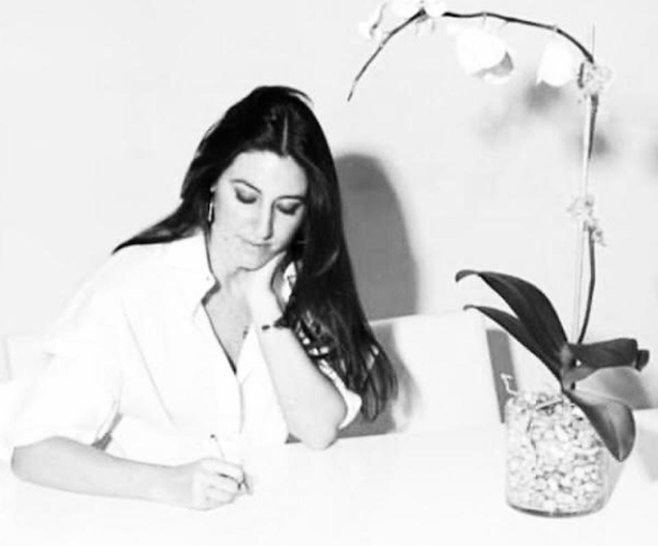 Designer Caroline Constas working in her Soho showroom.