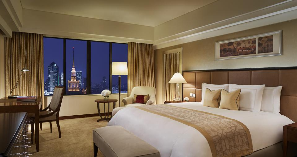 A Deluxe King, with the Shanghai Exhibition Center spire in the background, at the PortmanRitz-Carlton