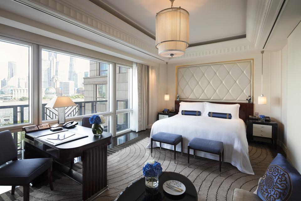 A Deluxe River Room facing the Huangpu River at The Peninsula Shanghai