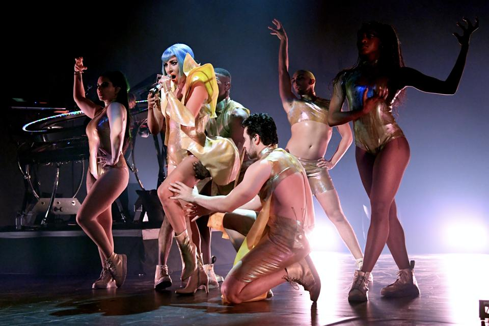 Lady Gaga performs with backup dancers at the Apollo Theater in Harlem.