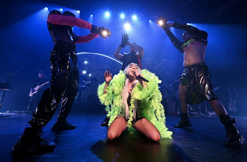 Lady Gaga belts out ″Paparazzi″ while flanked by three backup dancers.