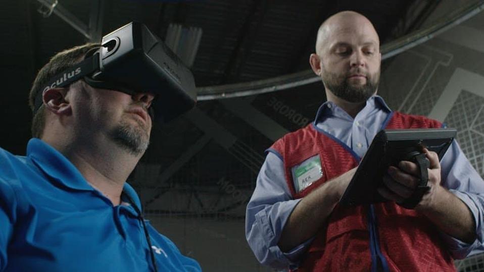 Lowes employee using virtual reality training tools.