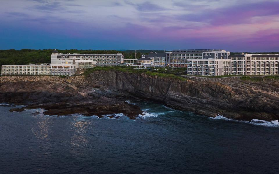 Sun sets over hotel on a cliff