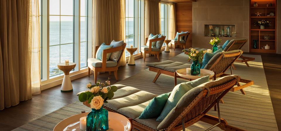 Interior chairs by the window overlooking the ocean