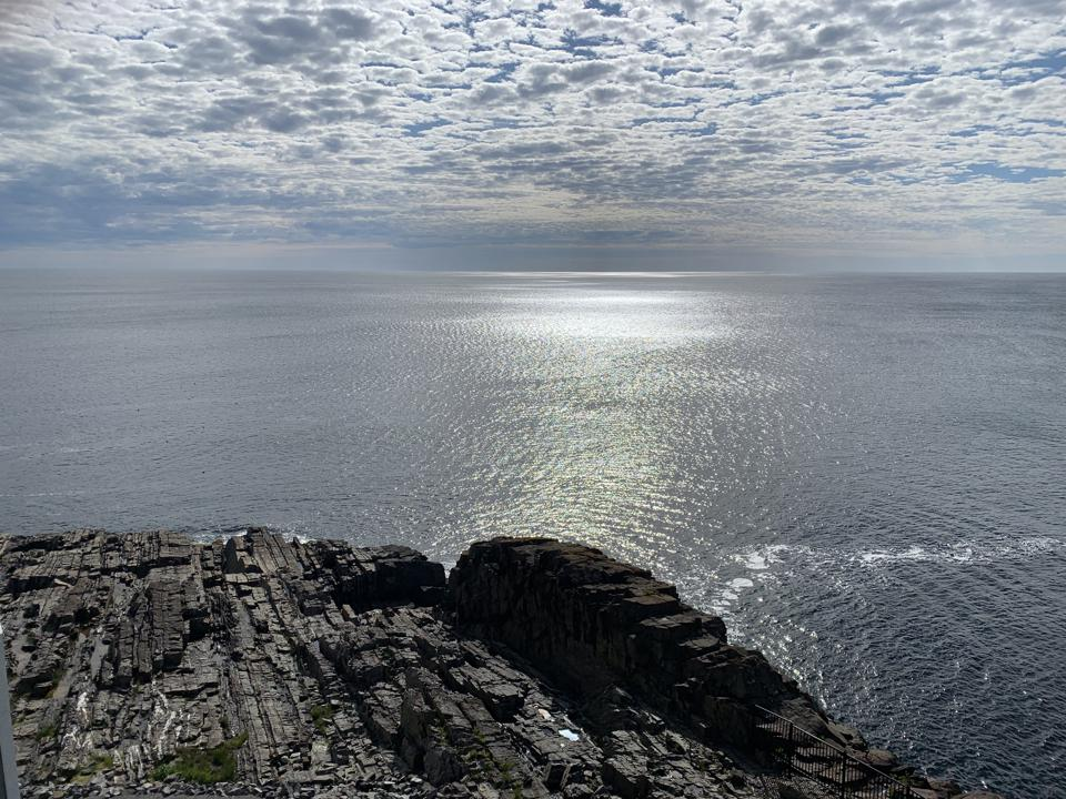 Ocean next to rocky cliff
