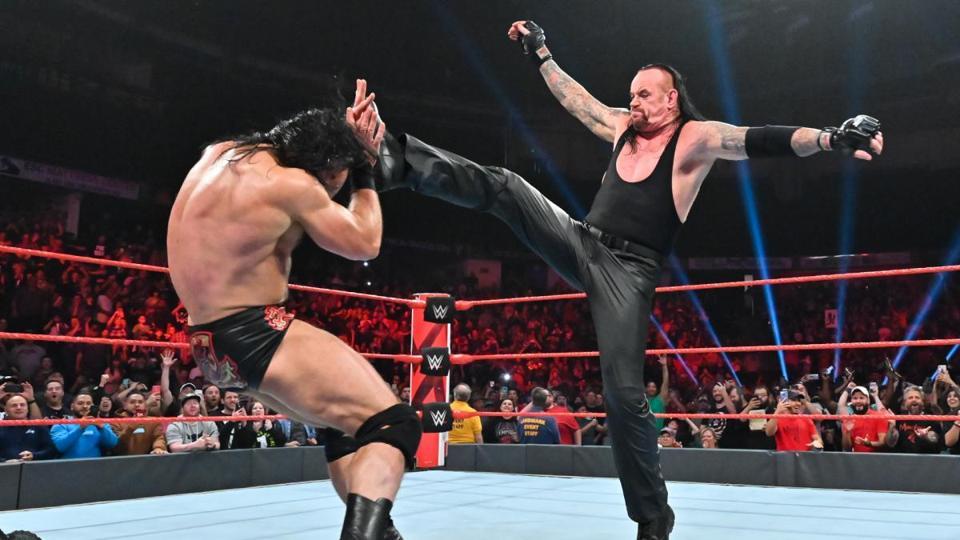 The Undertaker kicks Drew McIntyre