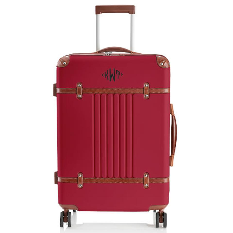 Red suitcase with leather detail