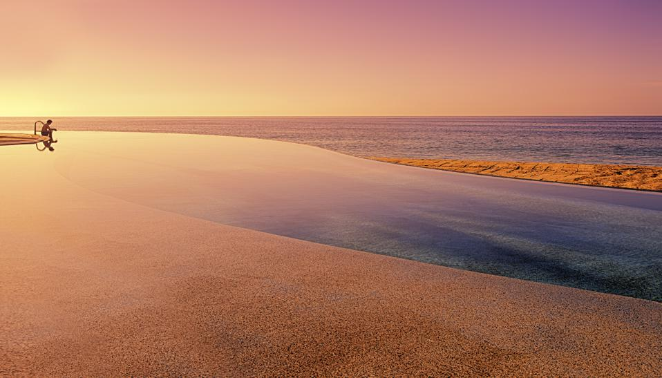 One of the Marquis Los Cabos' infinity pools at sunset.