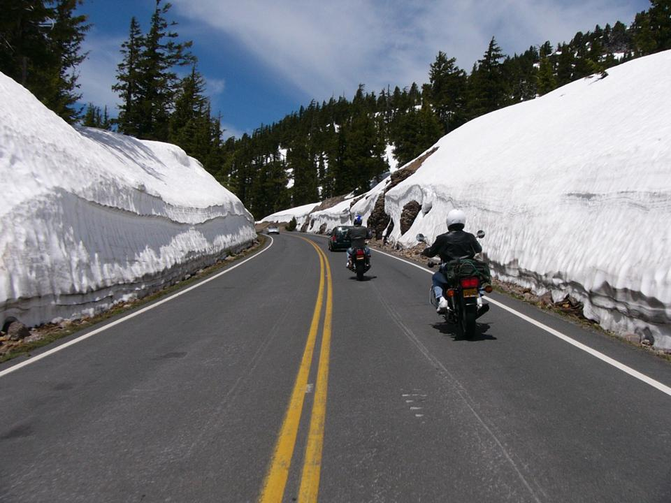 Towering walls of snow flank 33-mile long Rim Drive around Crater Lake in the early summer months.