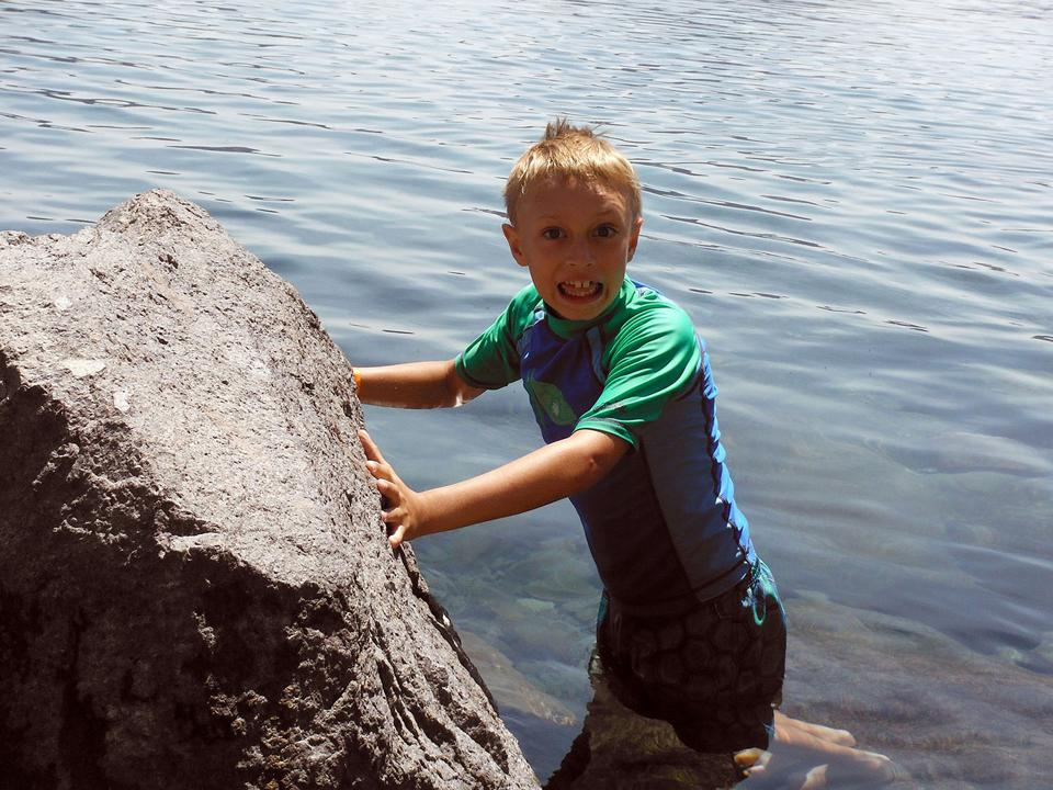 You can swim in Crater Lake, but be warned: It's usually quite cold as this youngster just discovered.