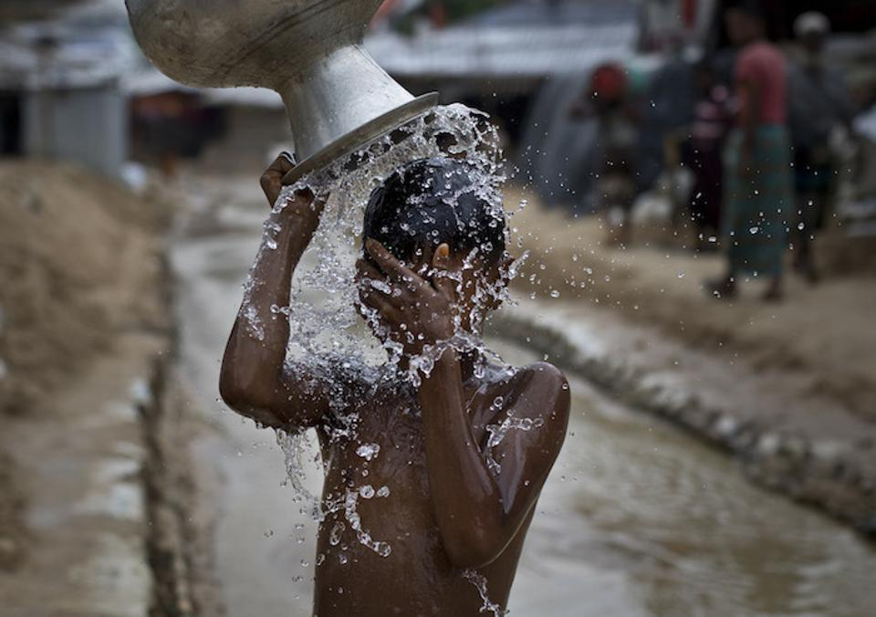 A boy washes at a UNICEF_supported camp for Rohingya refugees
