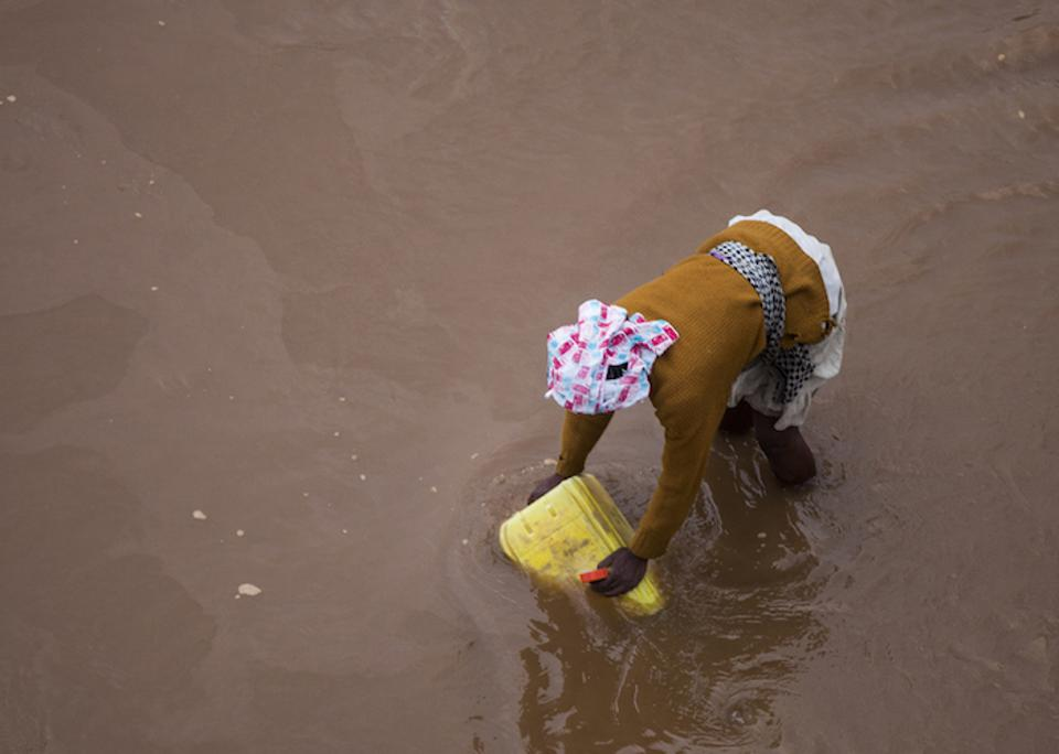 A woman draws water from a river in southern Madagascar.