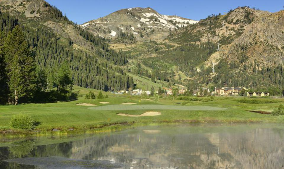 Mountains with trees and a golf course