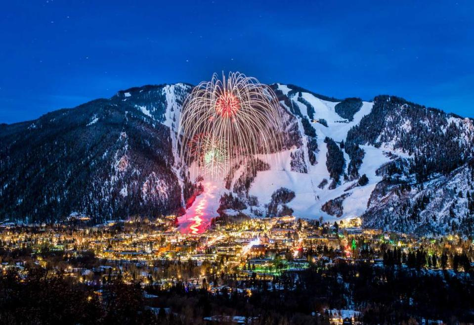 Fireworks light up Aspen Mountain during a Winter Carnival.