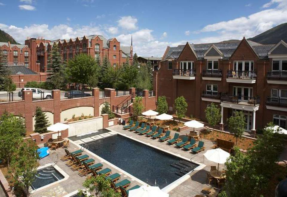 Guests enjoy the outdoor pool at Hyatt Residence Club Grand Aspen.