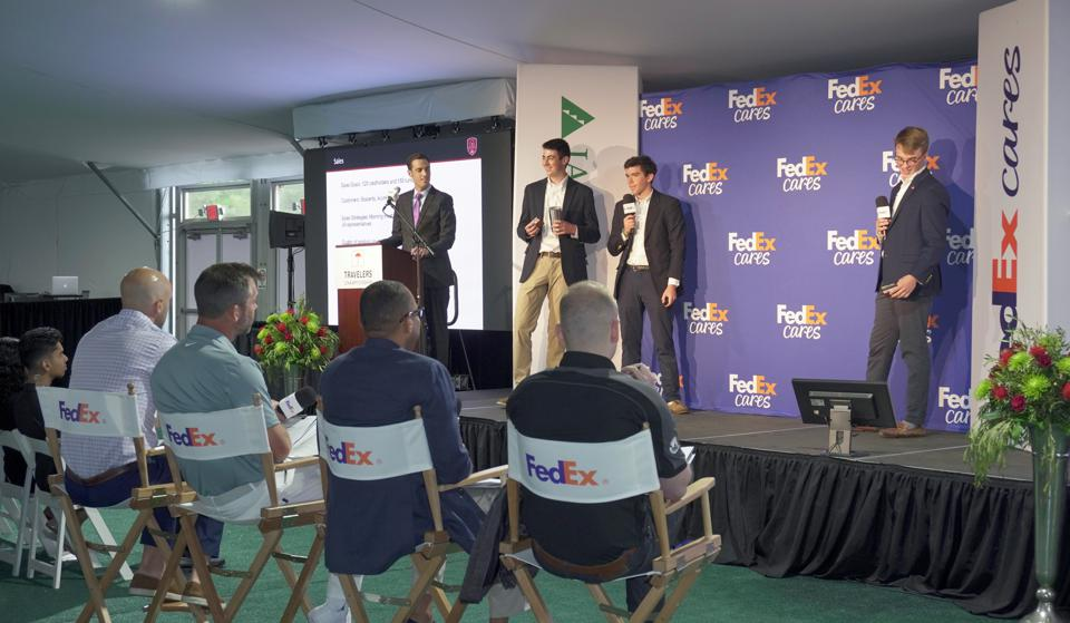 Students present their business idea to a panel of judges as part of the FedEx Junior Business Challenge.
