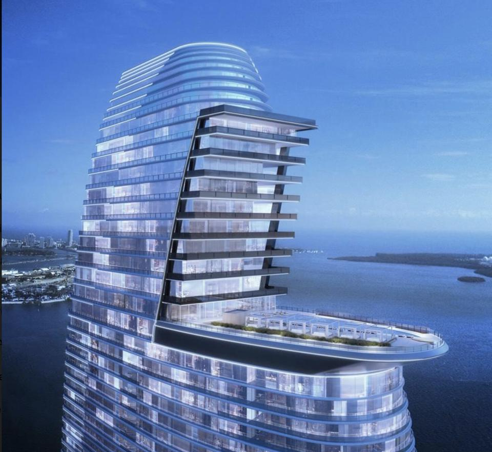 The windsail design allows the penthouse levels to look over the pool and cityscape beyond.
