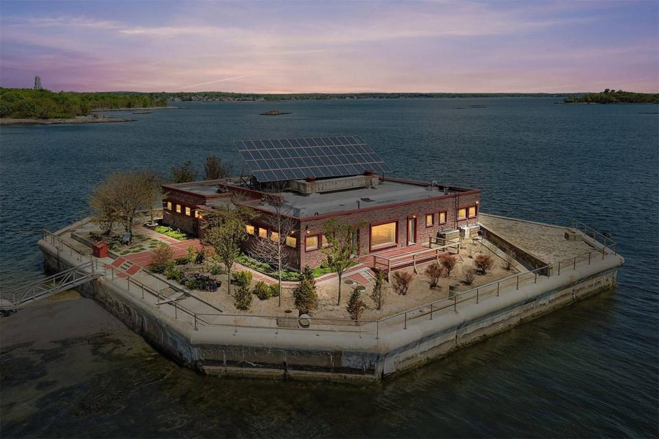 A brick home with solar panels on an island.