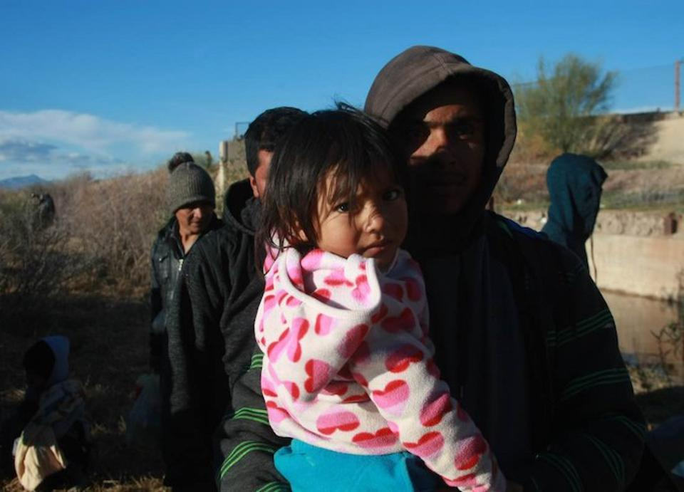 Many children like this little girl were among a group of 150 migrants fleeing extreme poverty in Central America who waited — without food — for three days at the border between Juarez and El Paso, Texas, last December in hopes of entering the U.S.