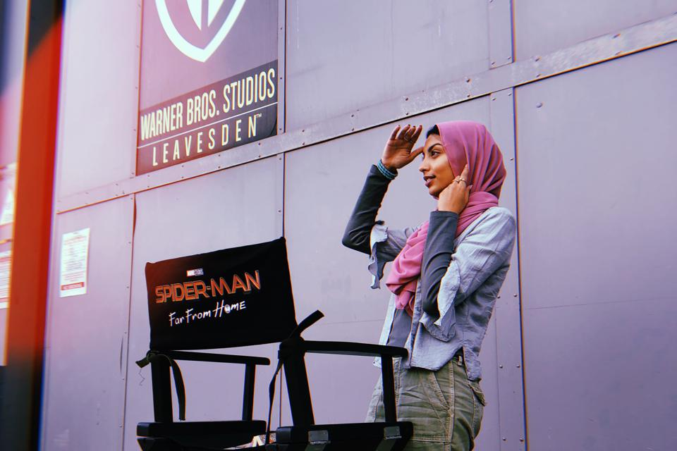 Zoha Rahman adjusts her costume on set.