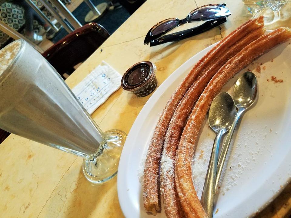 Churros, milkshake and chocolate dipping sauce.