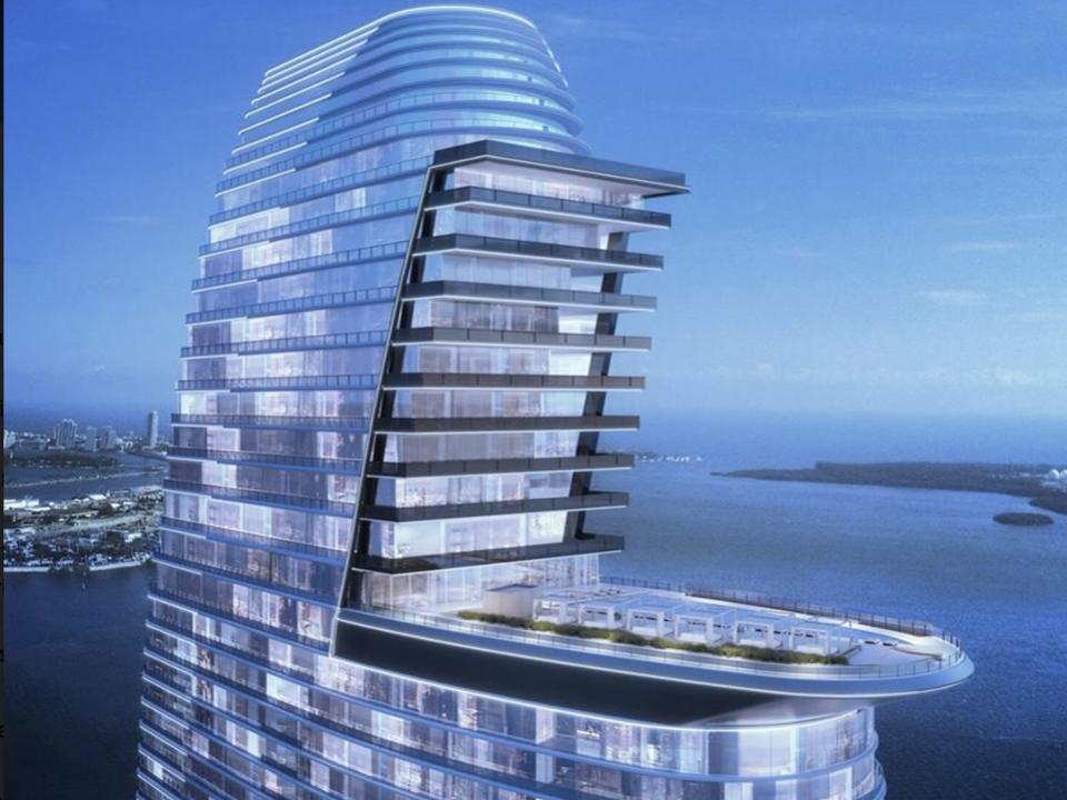 The windsail design allows the penthouse levels to look over the pool and cityscape beyond