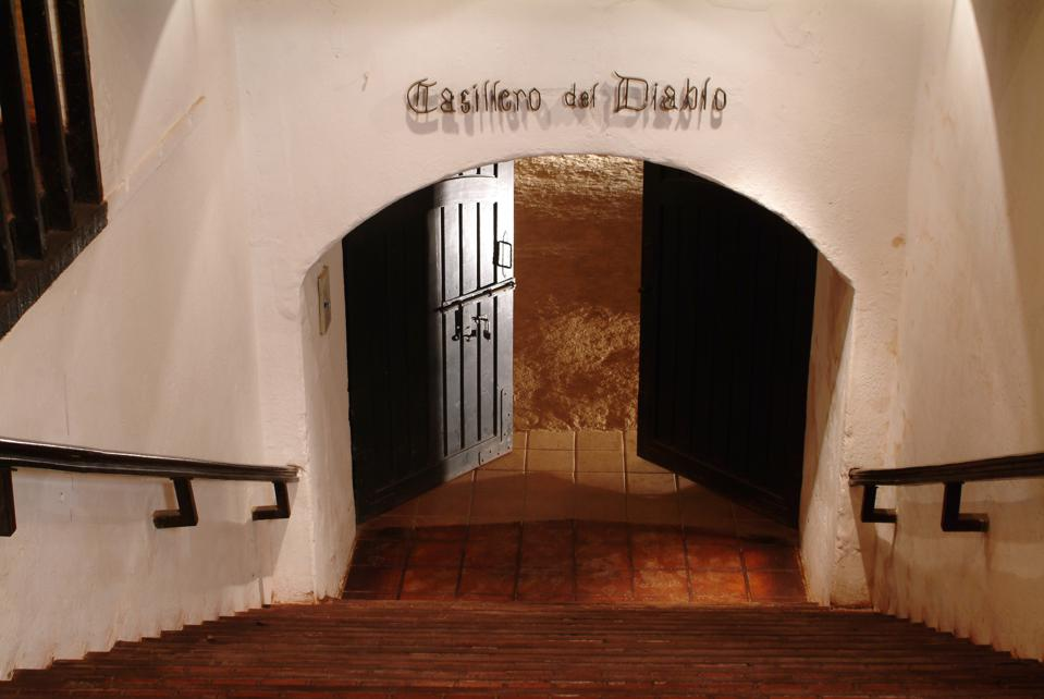 Looking down the stairs, two black doors stand open. Above, the words Casillero del Diablo