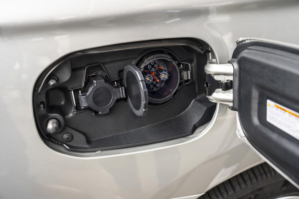 Gasoline and electric ports on the PHEV.