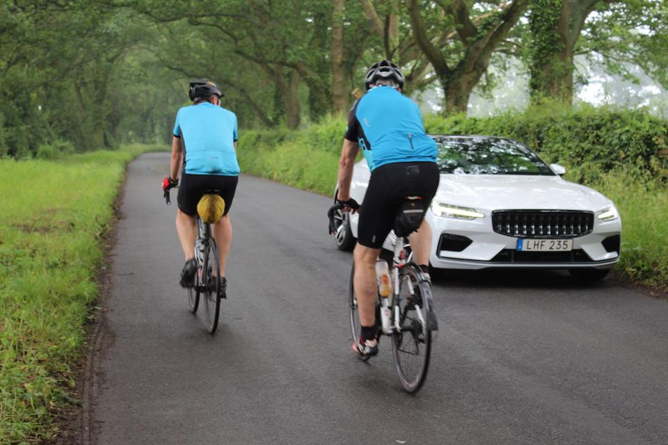 I drive on regular English country lanes largely unnoticed, bar these cyclists who are intrigued by the Polestar 1