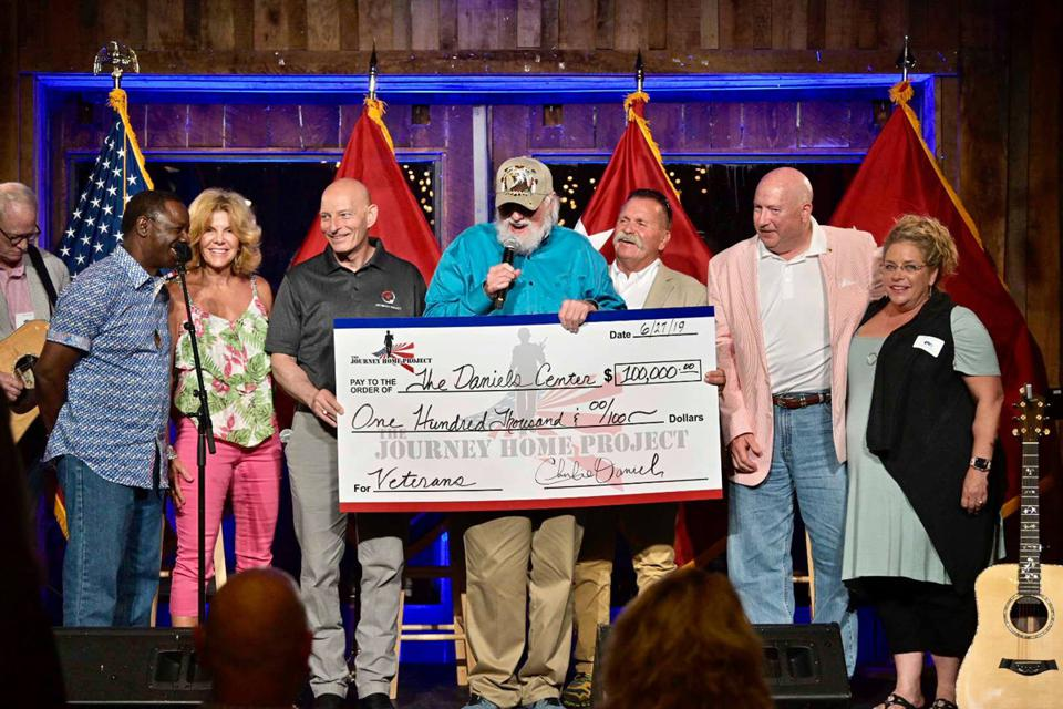 Charlie Daniels donates check to support Charlie and Hazel Daniels Veterans and Military Family Center at MTSU