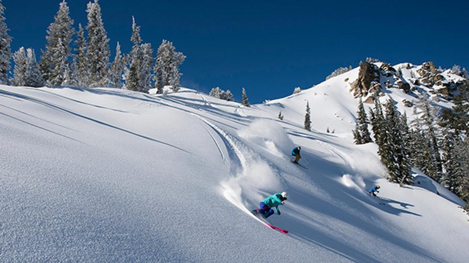 Skiers ride the powder at iconic Squaw Valley ski resort.