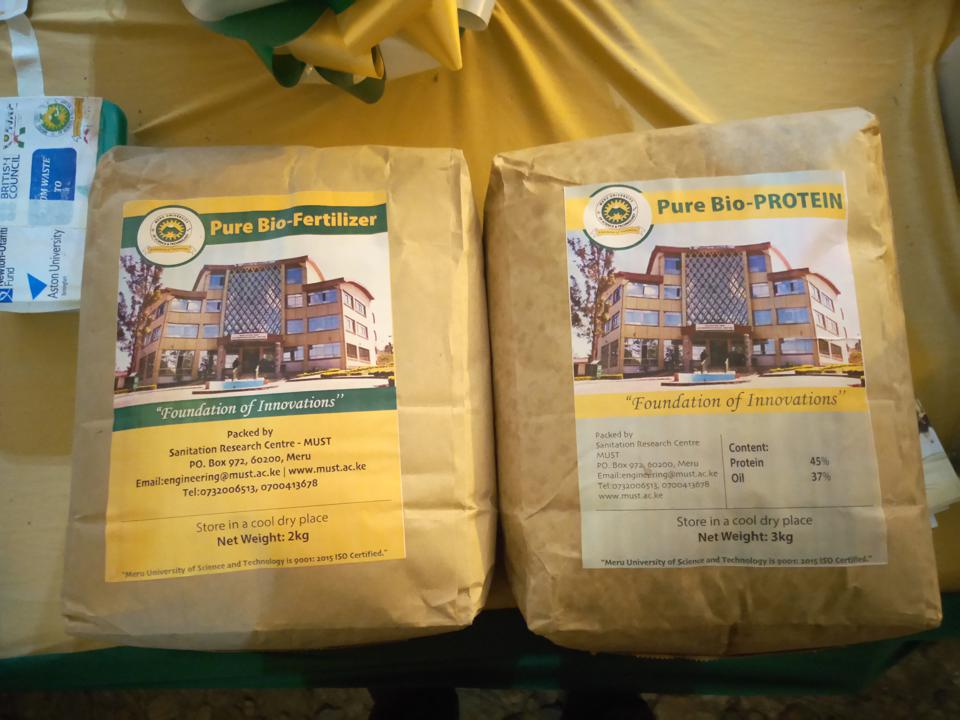 Two paper packages, one labeled ″Pure Bio-Fertilizer″ and the other labelled ″Pure Bio-PROTEIN″