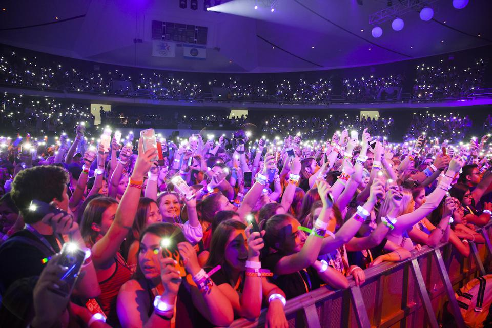 VidCon fans in the Anaheim Arena holding phones aloft with lights turned on