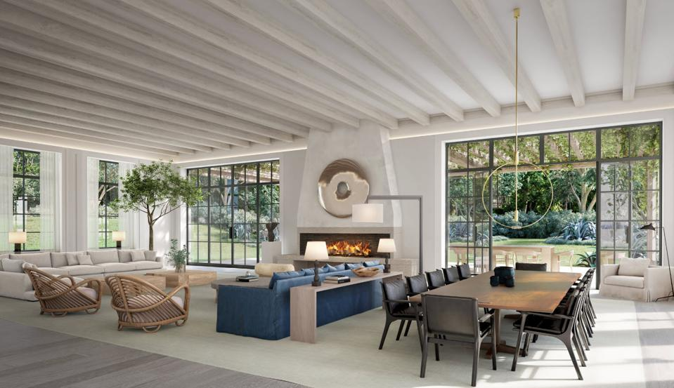 An indoor-outdoor living room concept with a modern fireplace.