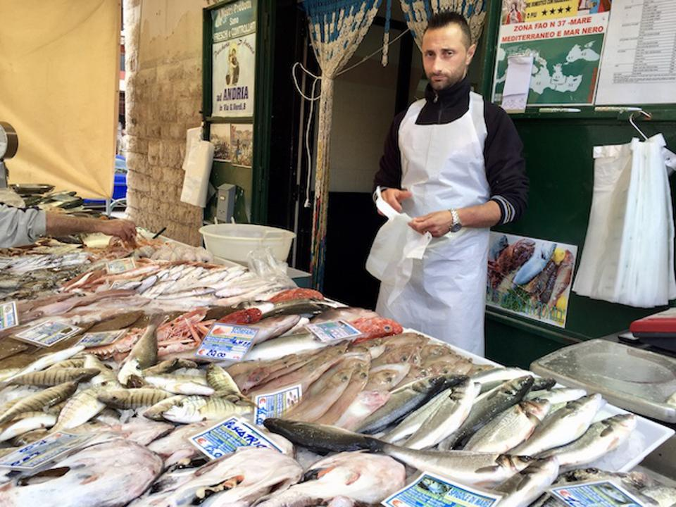 Fishmonger in a stall at the Bisceglie market